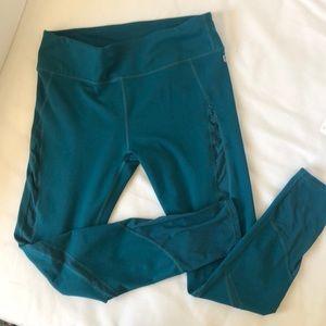 Fun green Fabletics leggings with mesh detailing